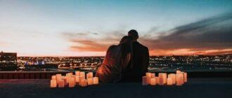 A man and a woman admire the sunset