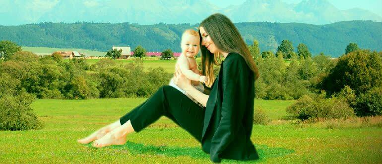 Mom sits with the child in nature